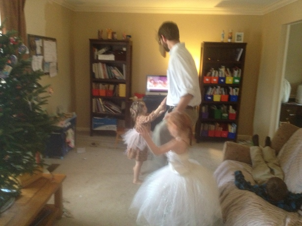 Dancing with Daddy. Sunshine wore a tutu over her church dress and then left it out, allowing Miss M to abscond it and take over.