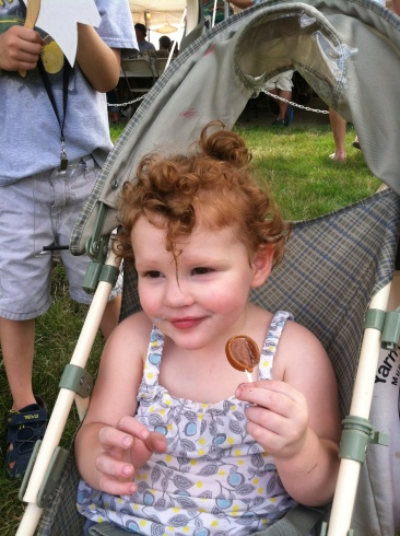 Note cotton candy stains on face as she enjoys that brown sugar lolly courtesy of Grandpa. Can we say sugar coma? ;)
