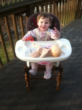 "Back on a balmy winter day, Littlest was ""babysitting"" Dollie for her big sister."